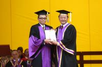 Prof. Cheng (left) receives the award from the Provost of CUHK