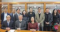 Prof. Fung Tung (middle at front row) poses for a group photo with delegates from Fudan University