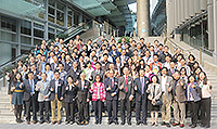 Participants pose for a group photo in front of Yasumoto International Academic Park of CUHK