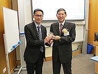 Prof. Edwin Chan (left), Professor of Life Sciences and Director of Laboratory of Drosophila Research, presents a souvenir to Prof. Chen Yuan-Tsong, Academician of Academia Sinica