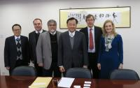 Members of Scientific Advisory Committee in meeting with Prof. Benjamin Wah, Provost (3rd from right)
