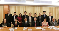 Mr. Tang Hao (third from the left in the front row) poses a group photo with other delegates and CUHK representatives