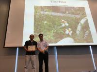 Dr. Lu Zengbing, First Prize winner (left) receives the certificate from Prof. Woody Chan