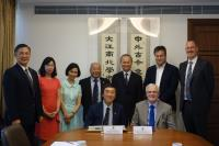 Group photo of Prof. Joseph Sung (left, front row), Prof. Sir Christopher Snowden (right, front row), Prof. Fok Tai-fai, Pro-Vice-Chancellor, CUHK (3rd from right, back row), Prof. Wong Shuk Ying, Associate Pro-Vice-Chancellor (3rd from left, back row), Ms. Shally Fan, Director, Office of Academic Links (2nd from left, back row) and Prof. Kenneth Lee (middle, back row) taken during the MOU signing ceremony