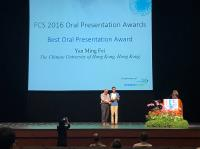 Mr. Yan Mingfei (right) receives the award certificate