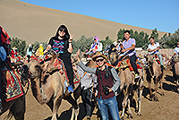 Journey through the Silk Road: riding camels in deserts (Photo credit: Miss Ko Chi Ying; programme host: Lanzhou University)