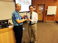 Prof. Raymond Chan, Chairman of Mathematics presented a souvenir to Prof. Liu Tai-Ping, Division of Mathematics and Physical Science, AS