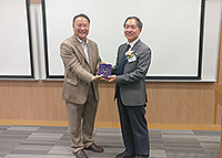 Prof. Lin Hui, Director of Institute of Space and Earth Information Science, presents a souvenir to Prof. Cui Peng
