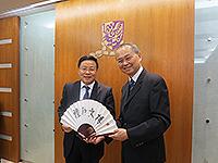Prof. Fok Tai Fai, Pro-Vice-Chancellor of CUHK, presents a souvenir to Prof. Liu Congqiang, President of Vice President of NSFC