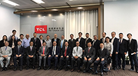 Guests post for a group photo at TCL Group