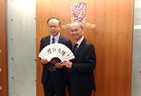 Prof. Fok Tai-fai (right), Pro-Vice-Chancellor of CUHK presents a souvenir to Prof. Chen Zhimin, Associate Vice-President of FDU