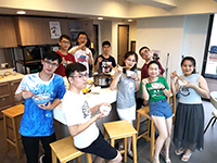 Participants enjoy hotpot at the hostel