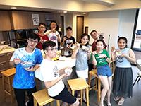 Participants enjoy hotpot at the hostel