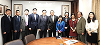 Professor Rocky Tuan (middle) of CUHK receives the delegation from PKU led by their President
