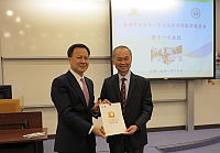 Prof. TF Fok (right), Pro-Vice-Chancellor of CUHK, poses a group photo with Prof. HP Xiao, Vice President of SYSU