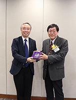 Prof. Tang Sze Wing (left) presents souvenir to Prof. Sun Tian-Shin