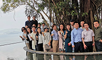 A group photo of executives from Fudan University at the Pavilion of Harmony of CUHK