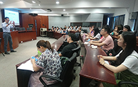 Professor Edwin Chan (left) shares his views on whole-person development and leadership with staff and students of NBU, illustrating the University's efforts into these two areas