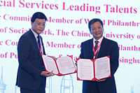 Prof. Steven Ngai (left), Department Chairman of Social Work of CUHK, announces the launch of 'Social Service Leading Talents Training Plan' with the representative from Tsinghua University.