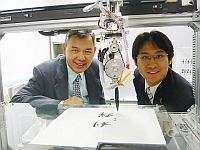 The Robotic Expression of Acquired Penmanship (REAP) is a robot that attempts to learn Chinese calligraphy and painting by imitation. It is developed by Prof. Yam Yeung (left), Chairman of the Department of Mechanical and Automation Engineering, CUHK, and Josh Lam, his PhD student
