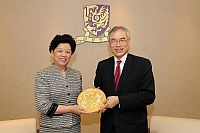 President of the All-China Women's Federation Ms. Chen Zhili (right), also vice chairperson of the Standing Committee of the National People's Congress presents a souvenir to Prof. Lawrence J. Lau (left), Vice-Chancellor of the Chinese University of Hong Kong