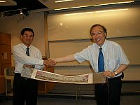 Prof. Jia Yimin (left), Vice President of Jinan University presents a souvenir to Prof. Jack Cheng (right), Pro-Vice-Chancellor