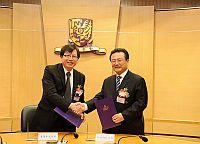 "Mr. Akbar Majit (right), Editor-in-chief of Chinese Writers Press Group and Prof. Ho Che-wah (left), Chairman of Chinese Language and Literature of CUHK sign a memorandum of understanding for academic collaboration on ""Writer@CUHK programme"""
