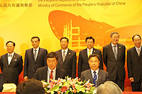 Prof. Joseph Sung (left, front row), Vice-Chancellor of CUHK and Prof. Yang Huanming (right, front row), President of BGI sign the MOU on clinical genomic collaboration under the witness of Mr. Li Keqiang (2nd from left, back row), Vice-Premier of the State Council