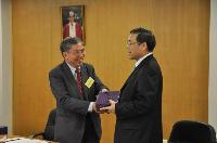 Prof. Chan Wai-Yee, SBS Director presented souvenir to Mr. Liu Qian, Vice-Minister of Health