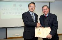 Prof. Chan Wai-Yee (right) receives the Appointment Certificate as Adjunct Professor from Prof. Jiang Wenqi, Director of School of Medicine, SZU
