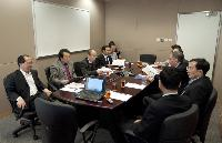Prof. Zhang Yaping and the CAS delegation (on the left) in meeting with SBS members (on the right)