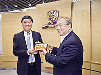 Prof. Lu Yongxiang (right), Vice-Chairman, Standing Committee of the National People's Congress of the People's Republic of China receives a souvenir from Prof. Joseph Sung (left), Vice-Chancellor of CUHK