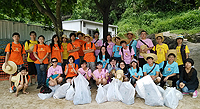 Students participate in a beach cleanup