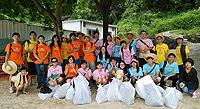Students participate in a beach cleanup
