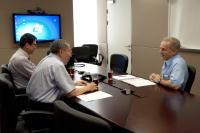 Prof. Chan Wai-yee (middle) and Prof. Stephen K.W. Tsui (left) meet with Prof. David Adelson (right)