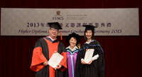 Dr. Clarence Yau (left) and Ms. Yumi Iida (right) receive the Teaching Award 2013