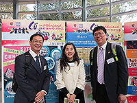 Photo taking with mainland partners in front of the booths