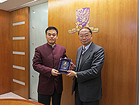 Prof. Henry Wong (right), Former Chairperson of Research Committee presents a souvenir to Mr. Lei Biao (left), head of the Zhongshan Municipal Party Organization