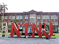Classmate and I jumping high in front of the NTNU sculpture