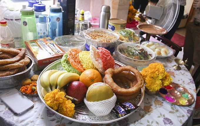 Nepali Tihar: Food offering and (on the right) the seven-colored powder for drawing tika