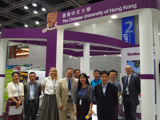 A group photo of participants taken at CUHK booth