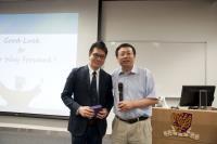Prof. Huang Yu (right) presents a souvenir to Dr. Alex Chan